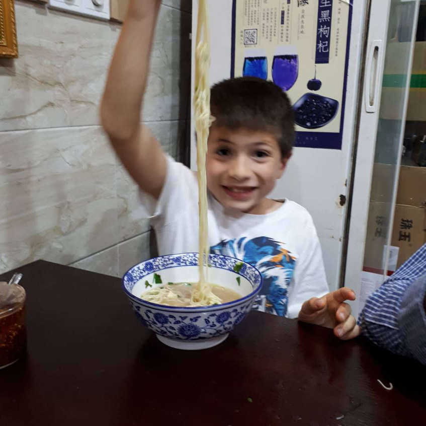 Antonio happily showing off the best noodles any of us had ever had in our lives.