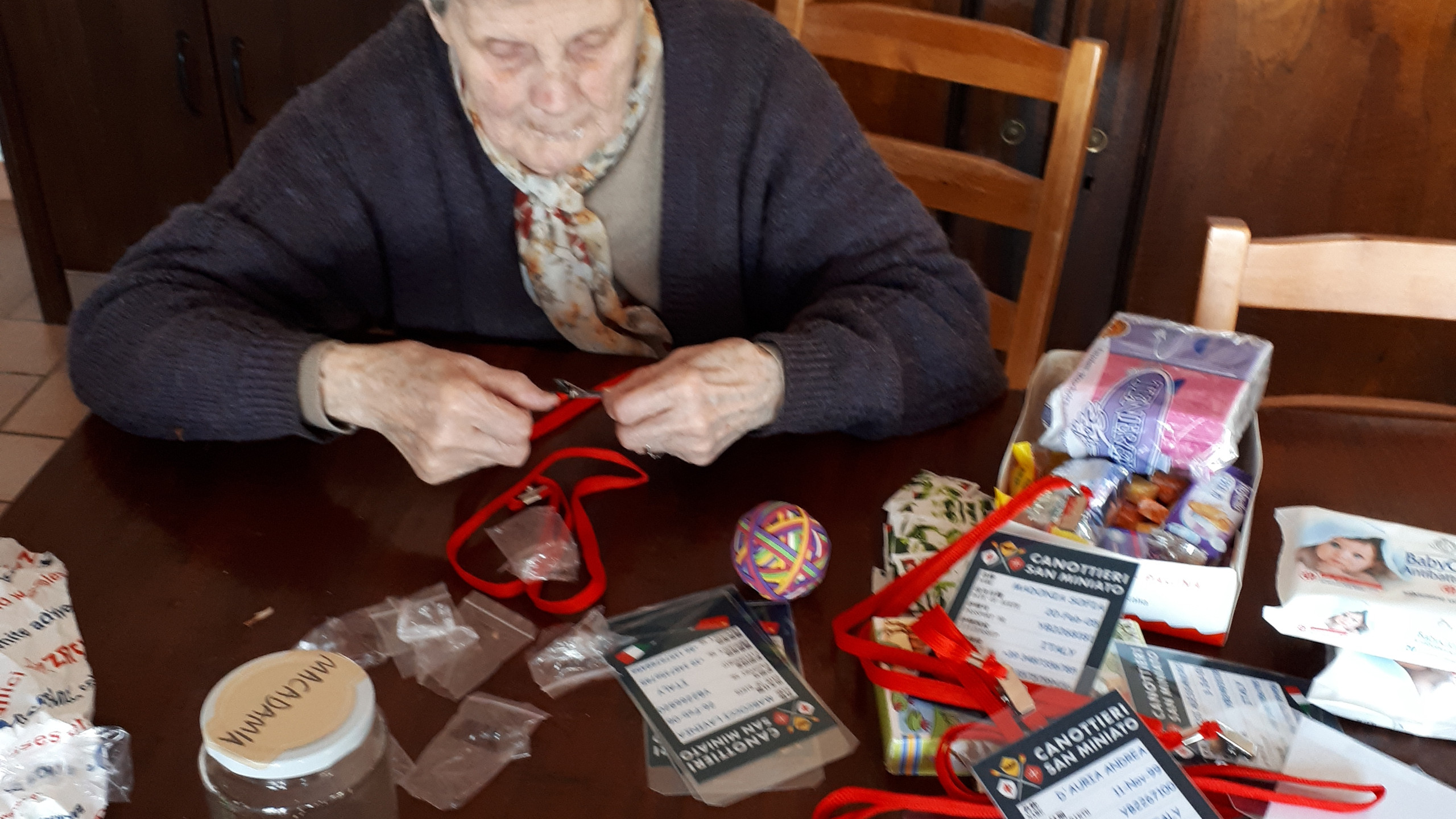 By April 27th, everyone was involved in getting the show on the road. Even Nonna Eda, here helping to assemble the namecards.