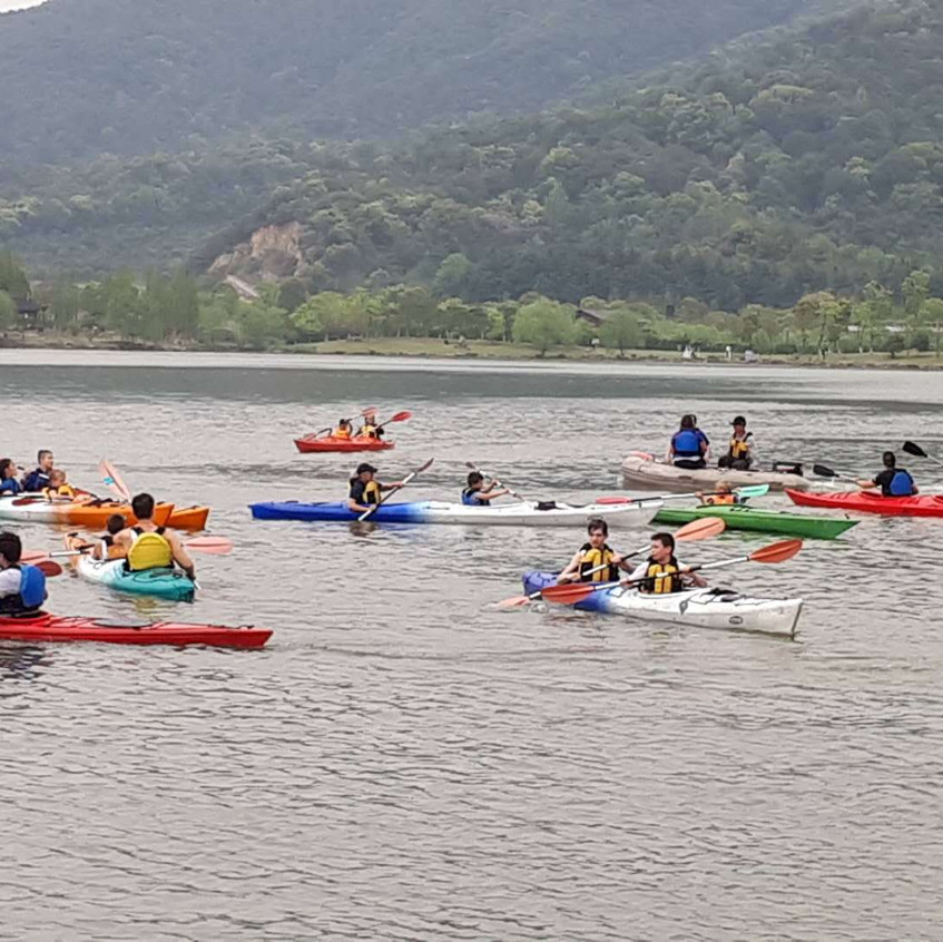 """Everyone gathered flocked to the scene when the girls """"accidentally"""" flipped their kayak..."""