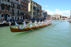 ...and we failed to limit our choice to one! This is Venetian rowing, standing up and pushing against the oars. On past trips we've learned to do this...it's much harder than it looks. We love Venice!
