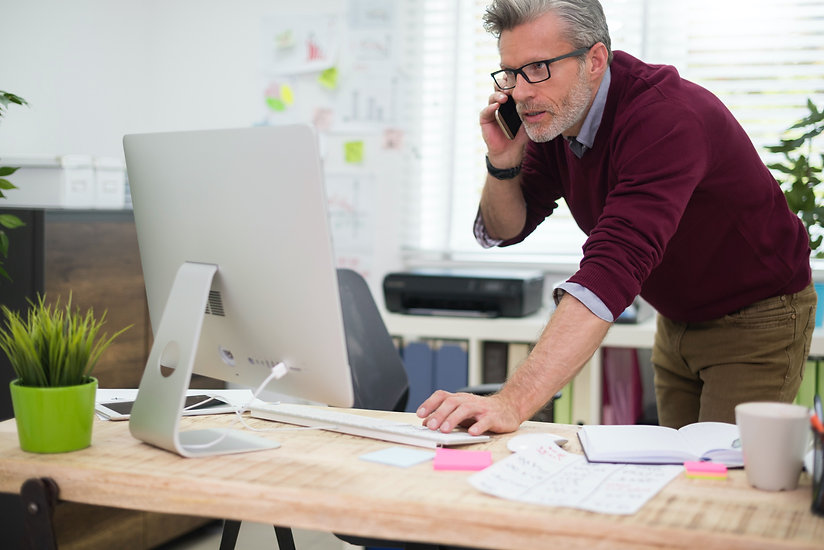 busy-man-using-telephone-and-computer-si