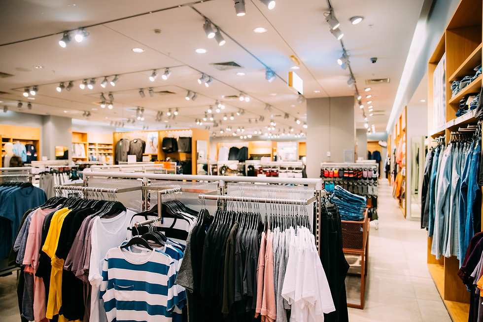 colorful-bright-clothes-on-shelves-and-h