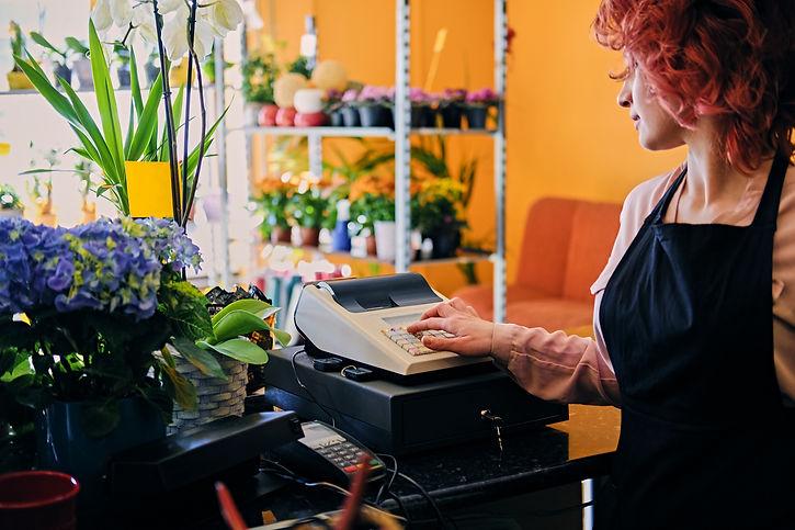 female-flower-seller-using-cash-register