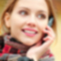 Woman With Phone Held to Her Ear