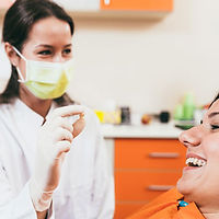 Dental Professional Interacting With a Patient
