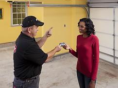Dealer handing the customer a garage doo