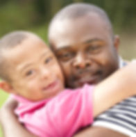 african american boy with down syndrome and his father, happy, Beacon 12, family, hug, special needs
