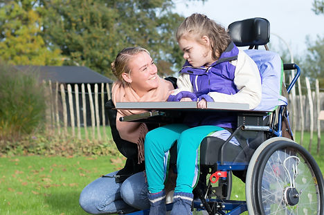 Young girl with disability, cerebral palsy, mom, caregiver, beacon 12, wheelchair, outside