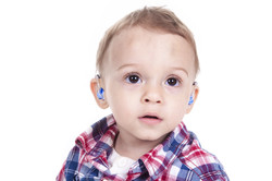 Little boy with hearing aids