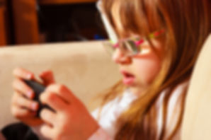 Seeing impaired young girl, glasses, game, cute, beacon 12, special need