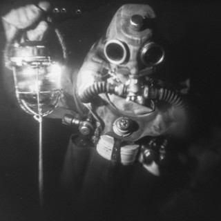 The picture was taken under water by a film camera of the size 18 by 24 cm. Monocle. Without a shutter. X-ray film. Flash Ikelite DS51. In the shooting process we used live saving diver's dry suite СПГ-К and sealing off rebreather ИДА-59М. Both were used as a diver's life saving equipment in Russian Navy for emersion from submarine (deep until 220 m).
