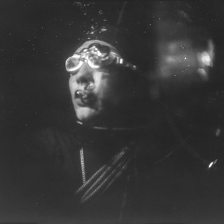 The picture was taken under water by a film camera of the size 18 by 24 cm. Monocle. Without a shutter. X-ray film. Flash Ikelite DS51. The model appearence is inspired by the japanesse ama and korean haenyeo.