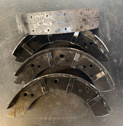 A set of racing brake shoes ready