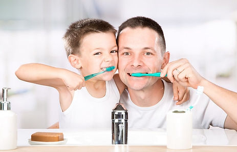 father-and-son-brushing-teeth-together-1