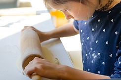 kid making pizza dough .jpeg