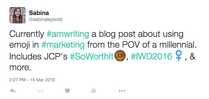 "Screenshot of my tweet to show the branded emoji that show up when using certain hashtags. It reads ""Currently writing a blog post about using emoji in marketing from the point of view of a millennial. Include's JCP's So Worth It, IWD 2016, and more."""
