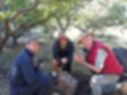 orchardWorkday20190629_JoePlaquePraying.