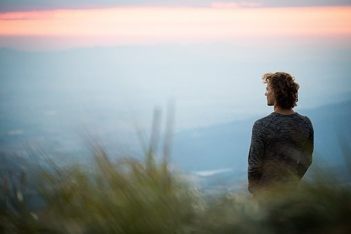 Lady looking out at a view. Walking can be a great way to reduce stress when you are going through a period of change