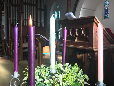Advent Candles Before the service started.. before Iris lit candle no 2!
