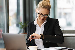 cheerful-business-woman-looking-at-watch.jpg