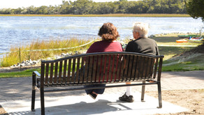 Swing and Bench in Sunset Beach Town Park Offer a Place to Sit and Stay a While
