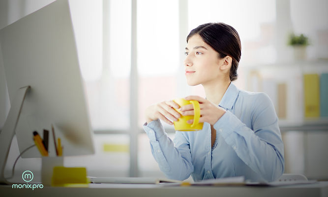 woman looking at pc with coffee  3x5.jpg