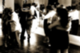 people dancing at a tango lesson