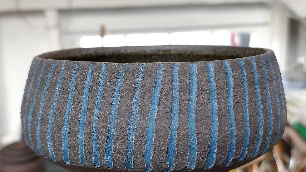 Blue fluted black bowl