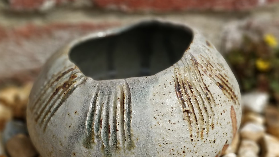 Freckled pot with uneven rim