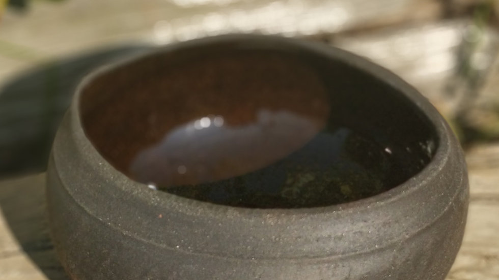 black bowl with oval rim