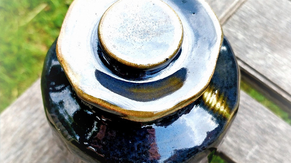 Faceted jar with lid, dark blueish green glaze