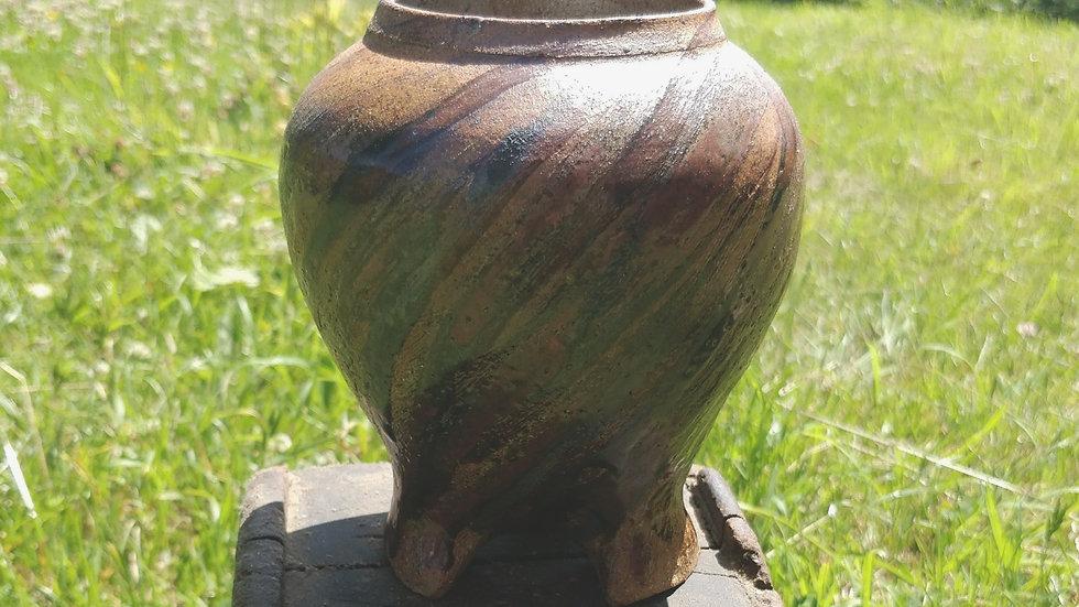 Hand-carved tripod vase