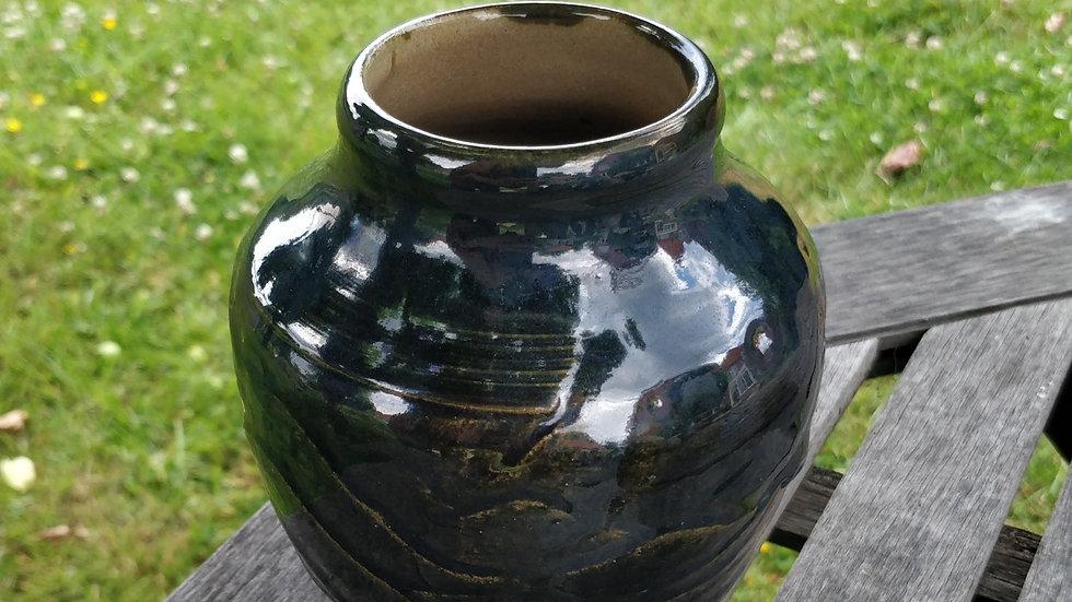 Hand carved stoneware vase in dark blueish green glaze