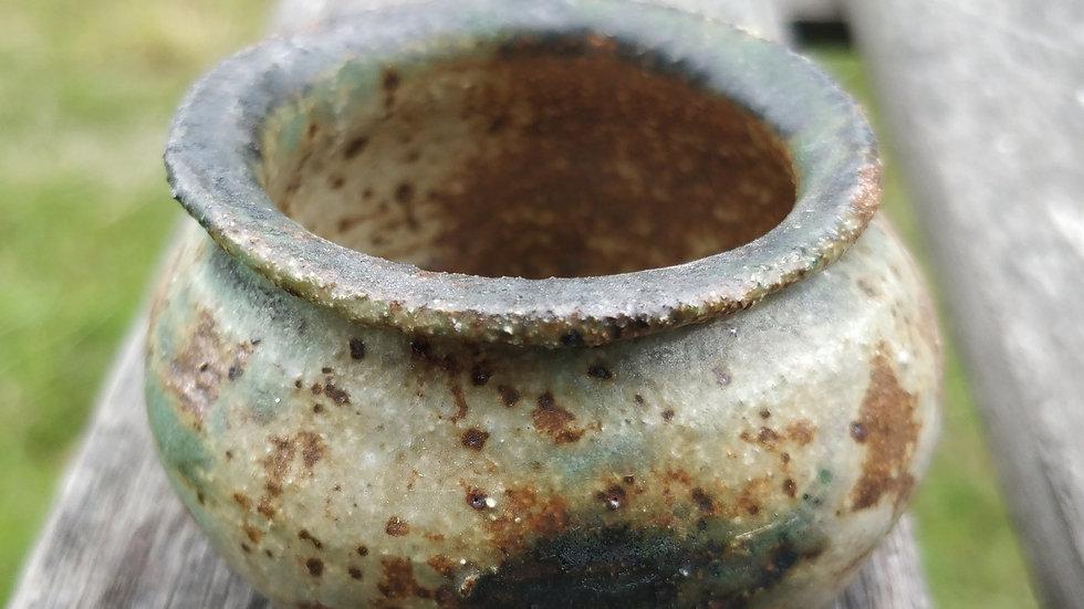 Small copper and ash pot