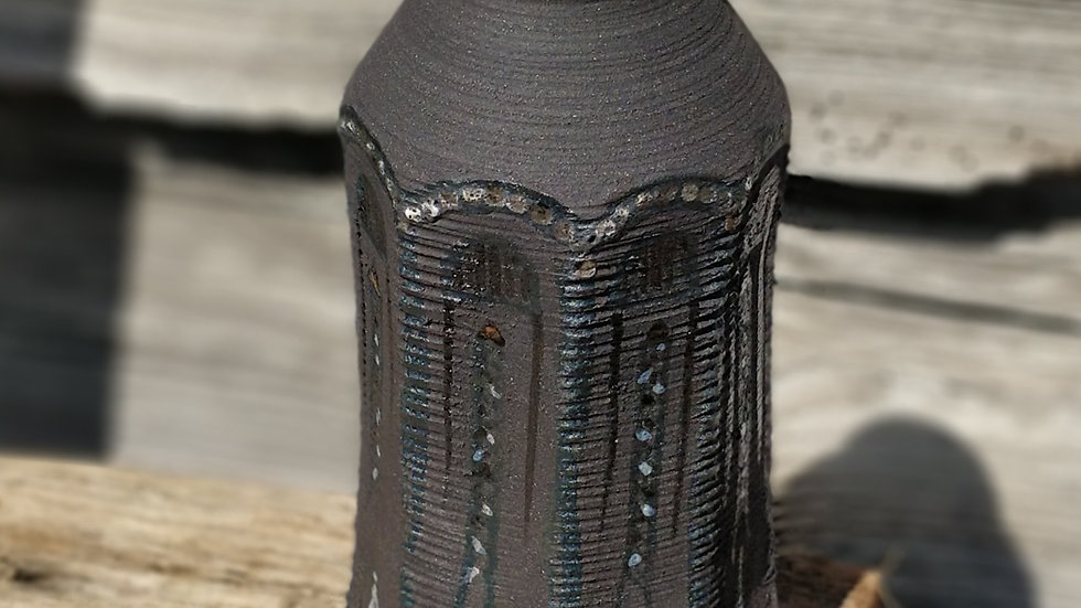 Faceted black vase