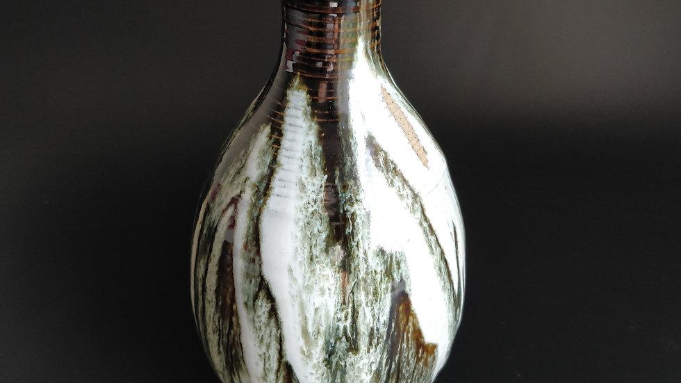 Vase in flowing ash