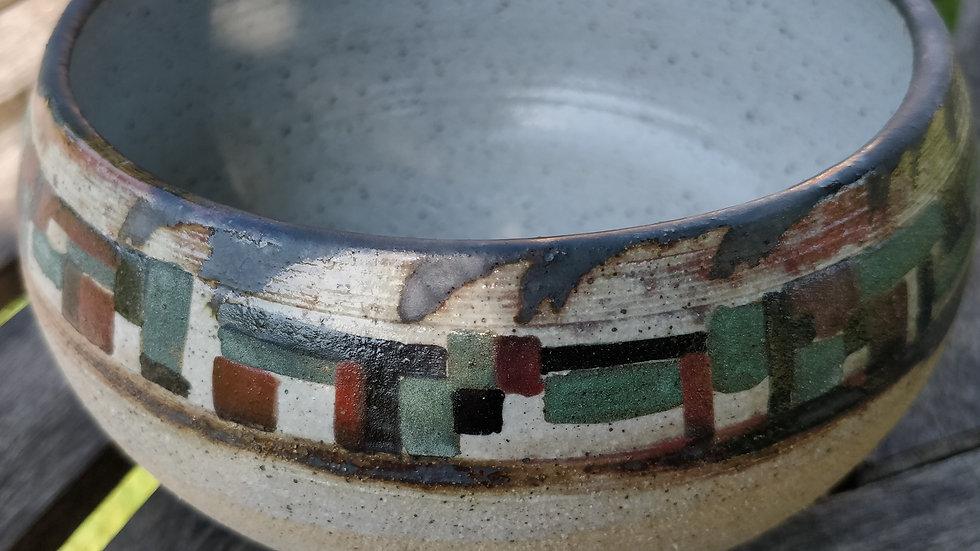 Stoneware bowl with underglaze patterns