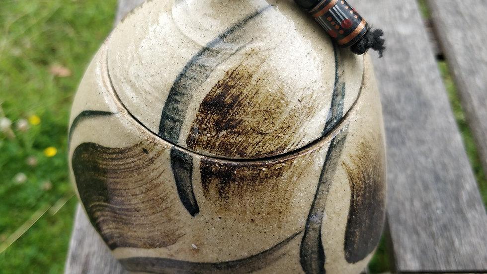 Triangular jar with beaded lid