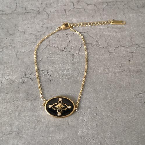 Bracelet chaînette acier doré et sa médaille fleur ovale en email noire