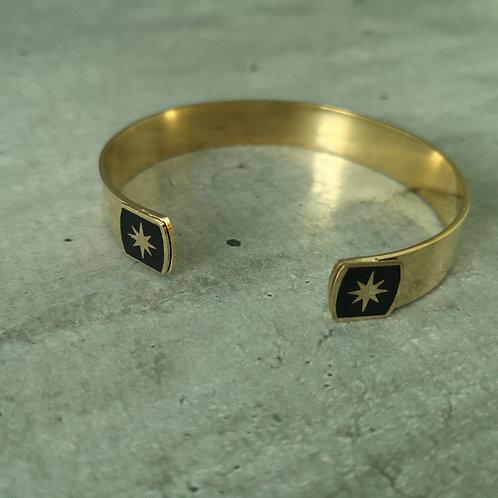 Jonc en acier doré bout carré noir avec étoile