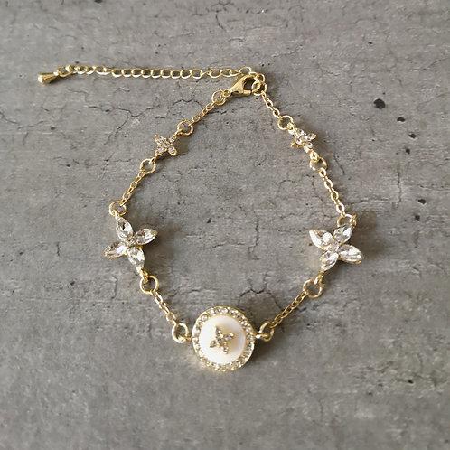 Bracelet chaînette acier doré médaillon nacre et strass