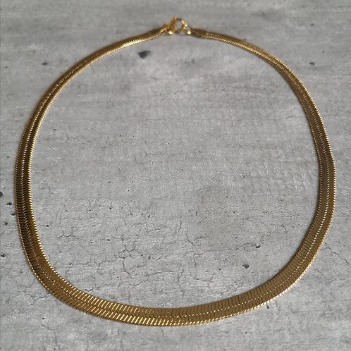 Collier ras du cou en maille serpent en acier doré
