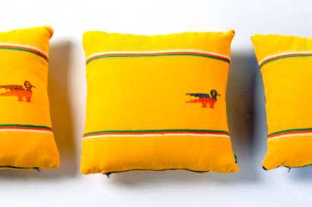Yellow pillow bird stitch