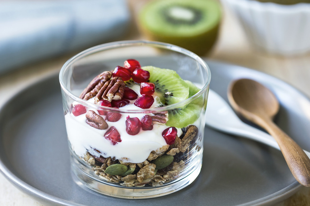 Yogurt, seeds, and fruit in glass cup