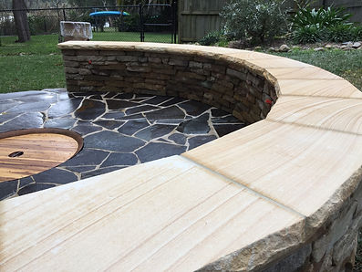 Testimonial for round firepit with bluestone crazy paving and raised sandstone seating