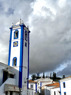 Clock tower on the village square in Messejana.