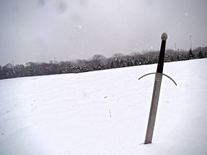 sword_in_the_snow_by_nathanielwilliam_d3