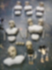 Image of puppet parts including heads, torsos and limbs. These puppets are from Wattle and Daub's puppet opera The Depraved Appetite of Tarrare the Freak.