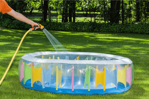 Image of a kiddie pool being filled with water