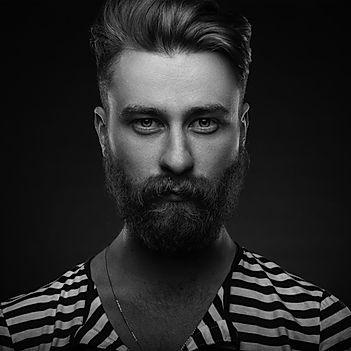 Hip bearded man in striped shirt
